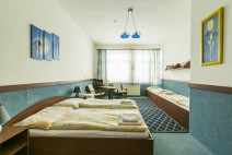 Čtyřlůžkový pokoj s posezením